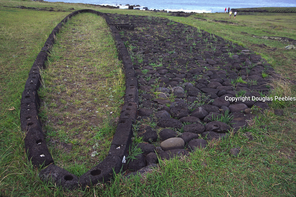 Long boat shaped home, Tahai Archeological site, restored 1988, Easter Island (Rapa Nui), Chile<br />