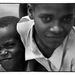 Two Ethiopian children fight for a chance to have their picture taken.