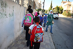Mohammed Haitham Obeidi, 7, is seen walking with his mother and sisters to his first day of school in Amman, Jordan, Aug. 20, 2007. His family fled Iraq after threats were made on his father's life. They are now awaiting asylum.
