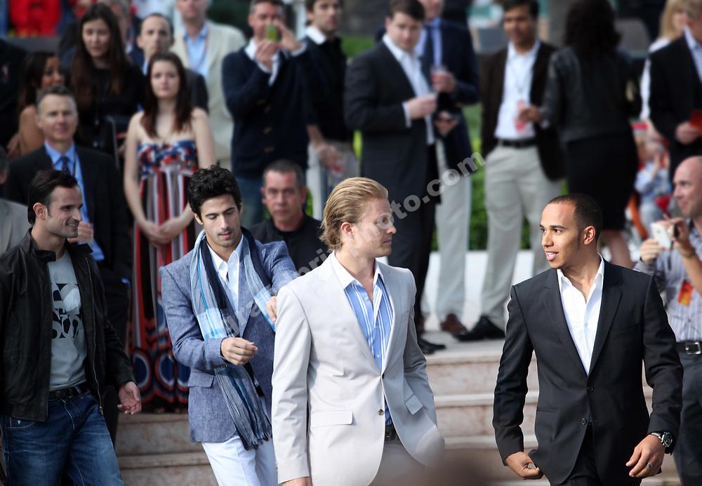 Nico Rosberg (Mercedes) Lewis Hamilton (McLaren-Mercedes), Lucas di Grassi (Virgin-Cosworth) and Vitantonio Liuzzi (Force India-Mercedes) at the Amber Lounge fashion show befoere the 2010 Monaco Grand Prix. Photo: Grand Prix Photo