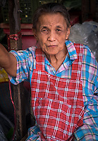 MAE KLONG - TAHILAND - CIRCA SEPTEMBER 2014: Portrait of Thai woman, a merchant of the Maeklong Railway Market