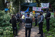 Bailiffs and officials serve legal documents in connection with an extended injunction recently granted to HS2 Ltd by the High Court to persons believed to be former inhabitants of a wildlife protection camp occupied by anti-HS2 activists on 21 September 2020 in Denham, United Kingdom. Anti-HS2 activists continue to try to prevent or delay works for the controversial £106bn HS2 high-speed rail link on environmental and cost grounds from a series of protection camps based along the route of the line between London and Birmingham.