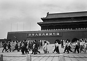 C008-32 Tom Hutchins_Young Pioneers and soldiers marching in front of Tien An Men, Peking (Beijing) 1956.tif