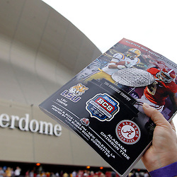 Jan 9, 2012; New Orleans, LA, USA; A vendor holds up programs before the 2012 BCS National Championship game between the LSU Tigers and the Alabama Crimson Tide at the Mercedes-Benz Superdome.  Mandatory Credit: Derick E. Hingle-US PRESSWIRE
