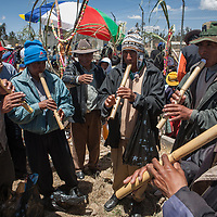 a traditional andean group of musicians play at a graveyard on the day of the dead in the altiplano of Bolivia.
