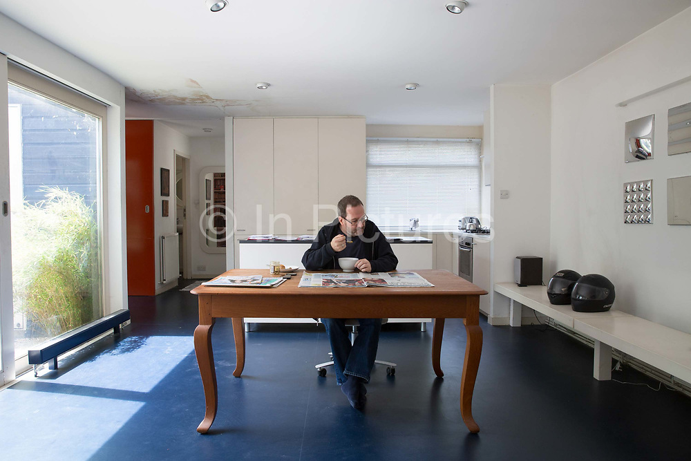 Adam Browne, freehold resident from Knights Walk estate on 1st June 2015 in  South London, United Kingdom.Knight's Walk is a collection of mostly bungalows; originally built for the elderly and disabled; that are a part of the Cotton Garden Estate in Kennington. Designed by architect George Finch and built between 1969-1972; the estate is currently being put forward for listing by the Twentieth Century Society.
