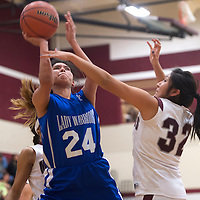 011113      Cayla Nimmo<br /> <br /> Ramah Mustang Wynter Henio (32) attempts to block a shot by Navajo Pine Lady Warrior Krystal Nelson (24) during the Tuesday night game at Ramah High School.
