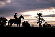 April 28, 2018: Queen's Cup Steeplechase. Jockey Darren Nagle takes a horse out for an early morning school in Camden SC