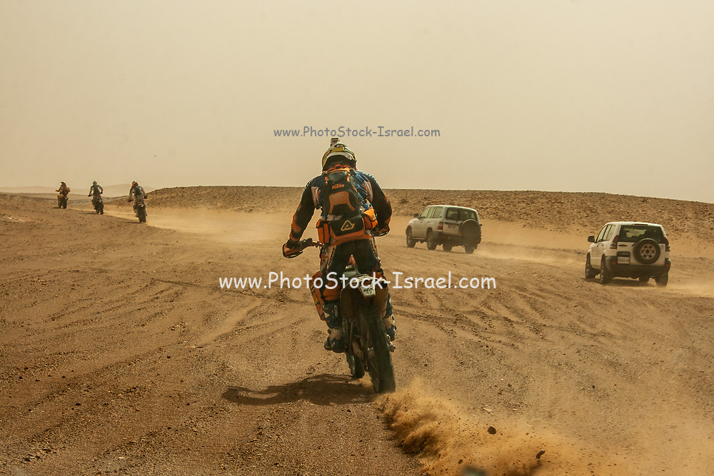 Extreme tourism. off road motorbikes and 4 wheel drive vehicles Photographed in Morocco