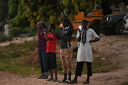 Locals take photos as The Prince of Wales and Duchess of Cornwall arrive in The Gambia, at the start of their trip to west Africa.