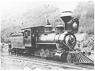 """RGS 2-8-0 #21 with crew of fireman Sam Davies and engineer Tom Mckinney at Rico.<br /> RGS  Rico, CO  summer 1892<br /> In book """"RGS Story, The Vol. V: Rico and the Mines"""" page 160<br /> Also in """"RGS Story Vol. V"""", p. 2 (enlarged); """"Silver San Juan"""", p. 104 and rear DJ; """"Narrow Gauge Country"""", p. 100 and """"The Rio Grande Southern Railroad"""", p. 129."""