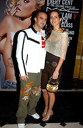 Model SOPHIE ANDERTON and MR MARK ALEXIOU at a party to celebrate Pamela Anderson's new role as spokesperson and newest face of the MAC Aids Fund's Viva Glam V Campaign held at Home House, Portman Square, London on 21st April 2005.<br /><br />NON EXCLUSIVE - WORLD RIGHTS