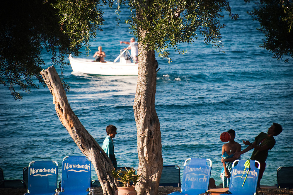 Italian tourists play beach volley in Manadendri bach at 19:00 Manadendri beach, Paxoi, Greece