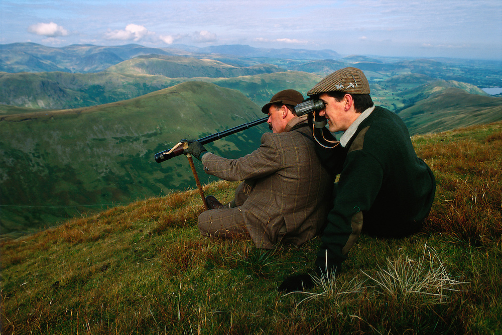 Two men examine the landscape of Northern England.
