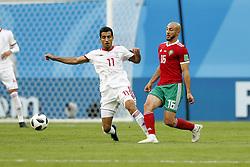 (l-r) Vahid Amiri of IR Iran, Nordin Amrabat of Morocco