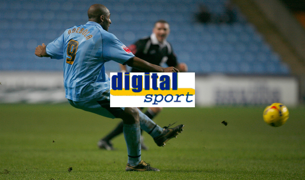 Dele Adebola of Coventry City shoots