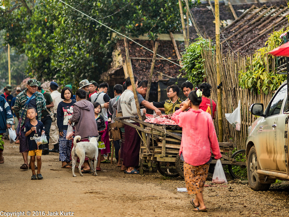 26 OCTOBER 2016 - NUPO TEMPORARY SHELTER, MAE CHAN, TAK, THAILAND:  The main road into the Nupo Temporary Shelter refugee camp. Sixtyfive Burmese refugees living in the Nupo Temporary Shelter refugee camp in Tak Province of Thailand were voluntarily repatriated to Myanmar. About 11,000 people live in the camp. The repatriation was the first large scale repatriation of Myanmar refugees living in Thailand. Government officials on both sides of the Thai / Myanmar border said the repatriation was made possible by recent democratic reforms in Myanmar. There are approximately 150,000 Burmese refugees living in camps along the Thai / Myanmar border. The Thai government has expressed interest several times in the last two years in starting the process of repatriating the refugees.    PHOTO BY JACK KURTZ