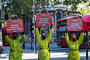 PETA supporters dressed in hazmat suits stage a protest against the use of exotic animal skins at London Fashion Week on Friday, Sept 18, 2020. People for the Ethical Treatment of Animals (PETA) is the largest animal rights organization in the world, with more than 3 million members and supporters. PETA educates policymakers and the public about animal abuse and promotes kind treatment of animals. PETA's animal protection work brings together members of the scientific, judicial, and legislative communities to stop abusive practices. (VXP Photo/ Vudi Xhymshiti)