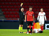 Referee Bartosz Frankowski of Poland gives a yellow card to Damien Da Silva of Stade Rennais during the UEFA Champions League, Group E football match between Stade Rennais and Sevilla FC (FC Seville) on December 8, 2020 at Roazhon Park in Rennes, France - Photo Jean Catuffe / ProSportsImages / DPPI