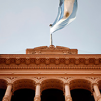 """Buenos Aires, Argentina 15 August 2009<br /> La Casa Rosada, officially known as the Casa de Gobierno or Palacio Presidencial, is the official seat of the executive branch of the Government of Argentina. The Casa Rosada sits at the eastern end of the Plaza de Mayo, a large square which since the 1580 foundation of Buenos Aires has been surrounded by many of the most important political institutions of the city and of Argentina.<br /> Its balcony, which faces the square, has served as a podium for most Argentine Presidents and a number of other historical figures, including Eva Perón, who rallied the """"descamisados """" from there, and Pope John Paul II, who visited Buenos Aires in 1982 and in 1987. Madonna, in 1995, sang her filmed rendition of the song """"Don't Cry for Me Argentina,"""" for the movie Evita.<br /> PHOTO: EZEQUIEL SCAGNETTI"""