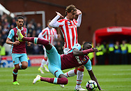 Marc Munisea of Stoke tackles Cheikhou Kouyate of West Ham .Premier league match, Stoke City v West Ham Utd at the Bet365 Stadium in Stoke on Trent, Staffs on Saturday 29th April 2017.<br /> pic by Bradley Collyer, Andrew Orchard sports photography.