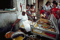 --- Women cook Bahian specialties at a street stand in Salvador, Brazil. Bahian food is a blend of Brazilian and African flavors. Photograph by © Owen Franken