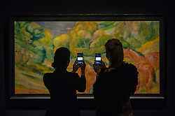 "© Licensed to London News Pictures. 28/01/2016. London, UK.   Visitors photograph ""Grosse Landschaft I (Large Landscape 1)"" by Franze Marc (est. £4-6m), on display at Sotheby's preview of its upcoming Impressionist, Modern & Surrealist art sale on 3 February featuring works by some of the most important artists of the 20th century.  The combined total of the evening sale is expected to exceed £100m. Photo credit : Stephen Chung/LNP"