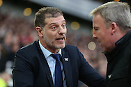 West Ham United manager Slaven Bilic talks to Kenny Jackett, the Wolverhampton Wanderers manager before k/o. The Emirates FA cup, 3rd round match, West Ham Utd v Wolverhampton Wanderers at the Boleyn Ground, Upton Park  in London on Saturday 9th January 2016.<br /> pic by John Patrick Fletcher, Andrew Orchard sports photography.