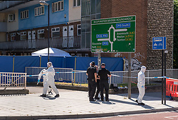 © Licensed to London News Pictures.  25/06/2018; Bristol, UK. Scene of murder with police and forensics a. A murder investigation has been launched after man dies and two are seriously injured in an armed burglary in Prewett Street, Redcliffe, in the early hours of the morning. It is reported that neighbours have told of hearing bloodcurdling screams of as three men were attacked with a sword-like knife. Two other men who suffered life-threatening injuries have been taken to hospital. It is reported that two men from London have been arrested in connection with the incident. Photo credit: Simon Chapman/LNP
