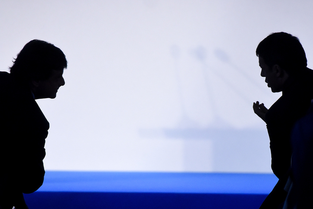 Milano, Italy - 21-09-2016: Minister of Economic Development, Carlo Calenda (L) and Prime Minister of Italy, Matteo Renzi (R), silhouetted during a meeting on Industry