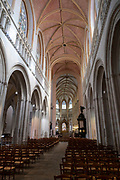 Interior of Saint Corentin Cathedral on 24th September 2021 in Quimper, Brittany, France. Gothic cathedral, begun in 1239, with soaring twin spires & 15th-century windows. Quimper is the ancient capital of Cornouaille, Brittany's most traditional region, and has a distinctive Breton Celtic character. Its name is the Breton word Kemper, meaning confluence. Brittany is a peninsula, historical county, and cultural area in the west of France, covering the western part of what was known as Armorica during the period of Roman occupation. It became an independent kingdom and then a duchy before being united with the Kingdom of France in 1532 as a province governed as a separate nation under the crown.