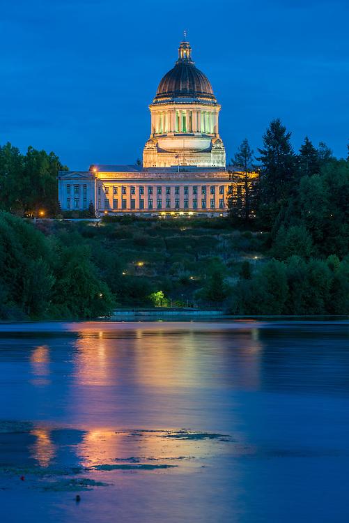 Washington State Capital building at night reflected in Capital Lake, Olympia, Washington.