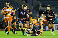 Darcy Graham is tackled by Tian Schoeman during the Guinness Pro 14 2018_19 match between Edinburgh Rugby and Toyota Cheetahs at BT Murrayfield Stadium, Edinburgh, Scotland on 5 October 2018.