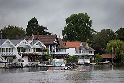 © Licensed to London News Pictures. 09/08/2021. Henley-on-Thames, UK. Rowers train in the rain and underneath grey skies, ahead of the the Henley Royal Regatta which starts on Wednesday, set on the River Thames by the town of Henley-on-Thames in Oxfordshire, England. Established in 1839, the five day international rowing event, raced over a course of 2,112 meters (1 mile 550 yards), is considered an important part of the English social season. Photo credit: Ben Cawthra/LNP