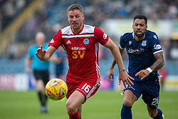 Ayr United's James Adams and Dundee's Kane Hemmings. Dundee 1 v 0 Ayr United, Scottish Championship game played 10/8/2019.