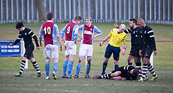 Edusport Academy Quentin Fouley injured. <br /> Whitehill Welfare 2 v 1 Edusport Academy, South Challenge Cup Quarter Final played 7/3/2015 at Ferguson Park, Carnethie Street, Rosewell.