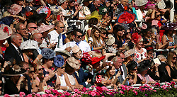 A crowd of racegoers watches on during day three of Royal Ascot at Ascot Racecourse. PRESS ASSOCIATION Photo. Picture date: Thursday June 21, 2018. See PA story RACING Ascot. Photo credit should read: Nigel French/PA Wire. RESTRICTIONS: Use subject to restrictions. Editorial use only, no commercial or promotional use. No private sales.