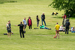 """© Licensed to London News Pictures; 16/05/2020; Bristol, UK. Police speak to people gathered in Victoria Park in Bristol, some of whom are taking part in a mass gathering protest against the lockdown restrictions of the Covid-19 coronavirus pandemic. Restrictions have been eased by the UK government but people should still not gather in groups of more than two people not in the same household or in groups of more than two people outside of their own household. One protestor made a statement as follows: """"This is a peaceful protest and she disagrees with Government policies and strategies of gross over-hyped response of what is a seasonal flu virus albeit a new strain. This does not justify full lockdown of the country's economy. Infections and deaths are less than 1% of general population and the Government is wrong to misdiagnose the whole population with flu virus that has not turned out to be an epidemic. The lockdown is unlawful and overrides democratic civil liberties. It is a disease of immunity and the Government's response is worse than the disease."""" (end of statement) Photo credit: Simon Chapman/LNP."""