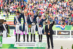 Podium Team Test 1. Germany 2. England 3. The Netherlands - Grand Prix Team Competition Dressage - Alltech FEI World Equestrian Games™ 2014 - Normandy, France.<br /> © Hippo Foto Team - Leanjo de Koster<br /> 25/06/14