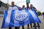 a group of Sheffield Wednesday fans pose outside Wembley Stadium before k/o. Skybet football league Championship play off final match, Hull city v Sheffield Wednesday at Wembley Stadium in London on Saturday 28th May 2016.<br /> pic by John Patrick Fletcher, Andrew Orchard sports photography.