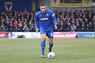 AFC Wimbledon defender Rod McDonald (26) dribbling during the The FA Cup 5th round match between AFC Wimbledon and Millwall at the Cherry Red Records Stadium, Kingston, England on 16 February 2019.