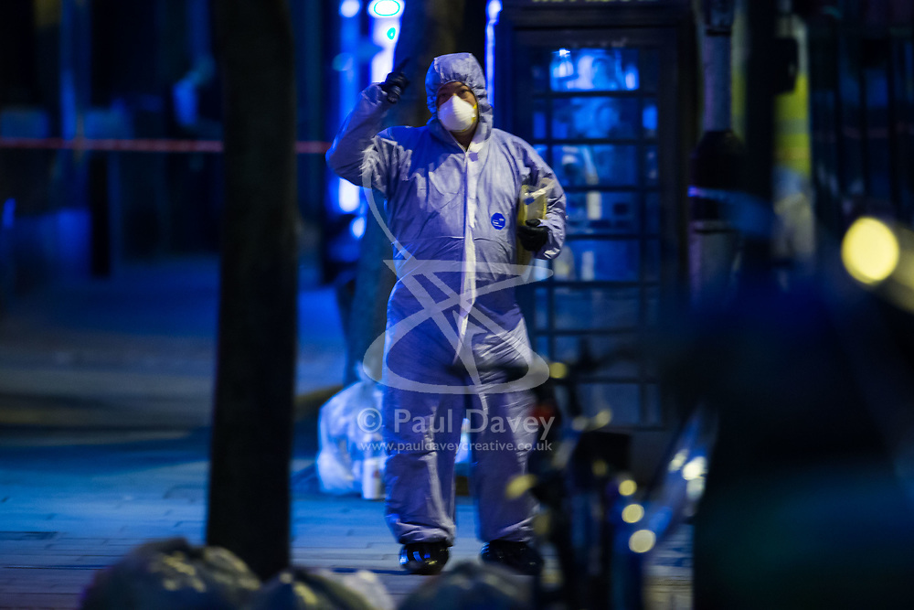 A forensics investigator at the scene following a fatal stabbing of a man in broad daylight at around 6.30pm on Upper Street in Islington, North London. London, May 21 2018.