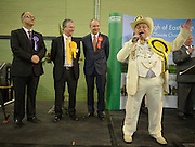 © Licensed to London News Pictures. 01/03/2013. Eastleigh, UK (left to right) DANNY STUPPLE - Independent, MIKE THORNTON - Liberal Democrats, DIANE JAMES - UK Independence Party, JOHN O'FARRELL - Labour watch HOWLING LAUD HOPE - Monster Raving Loony William Hill Party sing during his speech.  Ballot boxes begin to arrive at the count centre at  Fleming Park Leisure Centre in Eastleigh this evening. The voters of Eastleigh vote to choose a new MP in a by-election prompted by the resignation of former Lib Dem cabinet minister Chris Huhne. Polling will continued 22:00 GMT 28/02/13, with votes counted overnight on Thursday. There are 14 candidates in total on the ballot papers.. Photo credit : Stephen Simpson/LNP