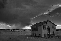 Epsie is a ghost town located west of Broadus, Montana. I'm not sure what this abandoned building used to be, perhaps a school or post office. I sat here and watched the supercell get stronger behind it.