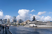 """The superyacht 'Kismet' is moored opposite Butler's Wharf, downstream on the river Thames from Tower Bridge and the capital's financial district's skyscrapers, on 20th October 2021, in London, England. 'Kismet' is a 95.2m (312 ft)-long superyacht which was built in 2014. It is managed by the Moran Yacht & Ship chartering business, and is owned by Pakistani-American billionaire Shahid Khan. 'Kismet' means """"destiny"""" or """"fate"""" in Khan's native Urdu."""