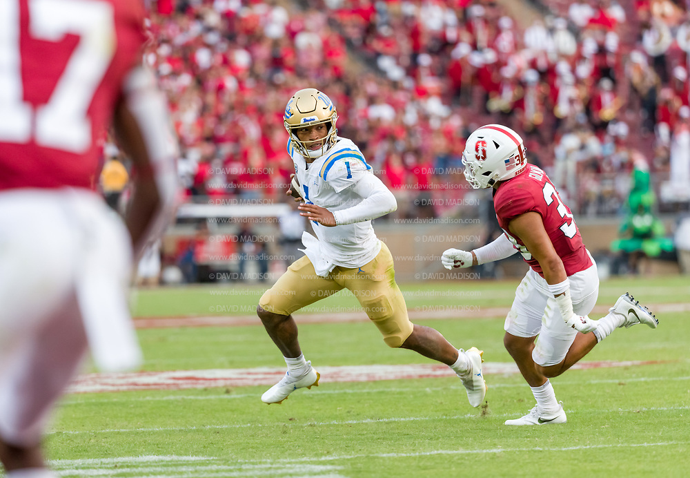 PALO ALTO, CA - SEPTEMBER 26:  Dorian Thompson-Richardson #1 of the UCLA Bruins scrambles during an NCAA Pac-12 college football game against the Stanford Cardinal on September 26, 2021 at Stanford Stadium in Palo Alto, California; defending is Alaka'i Gilman #33 of Stanford.  (Photo by David Madison/Getty Images)