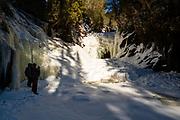 Frozen Cascade Falls on the Cascade River, on a cold winter day; Cascade River State Park, Grand Marais, Minnesota, USA.