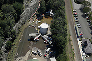 Heating fuel leaked from SOS Fuels in Tuxedo into the Ramapo River during flooding from Tropical Storm Irene. Cleanup is underway in this aerial photograph taken on Aug. 30, 2011.