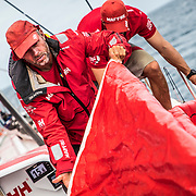 Leg 4, Melbourne to Hong Kong, day 18 on board MAPFRE, Rob Greenhalg packing a sail. Photo by Ugo Fonolla/Volvo Ocean Race. 19 January, 2018.