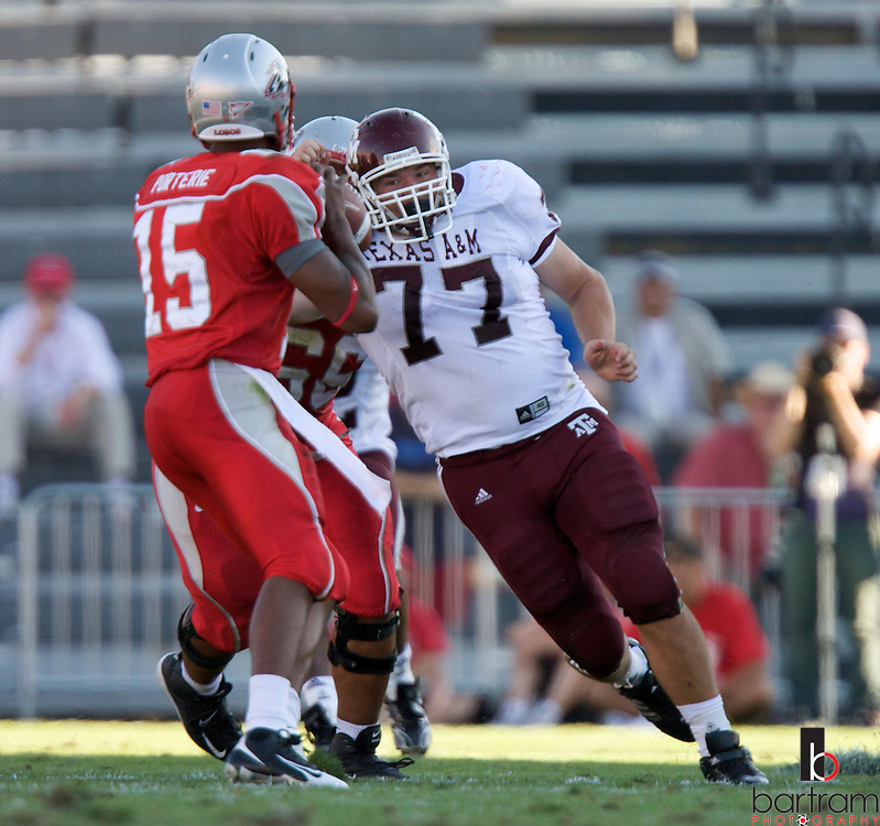 Texas A&M defensive lineman Lucas Patterson, right, goes for New Mexico quarterback Donovan Porterie at the University of New Mexico on Saturday, Sept. 6, 2008 in Albuquerque, New Mexico.